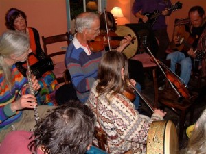Musicians playing at a folk night in Cwmdu Inn